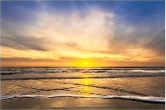Sunset Over Widemouth Bay Cornwall framed print by Paul Haddon