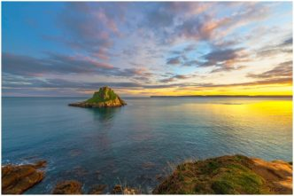 Evening Light Over Thatcher Rock Torquay Signed Limited Edition Framed Print by Paul Haddon